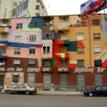 Tirana, Albania painted buildings throughout the city with bright designs to increase residents' sense of belonging and hope for the city's future. Photo by Joonas Lyytinen.